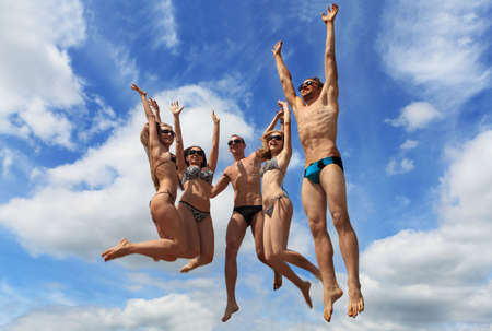 Cheerful young people having fun on a beach. Great summer holidays. Stock Photo - 5073894