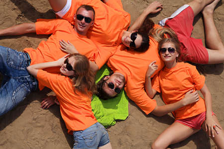 Cheerful young people having fun on a beach. Great summer holidays. Stock Photo - 5073903