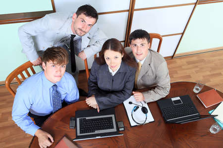 Business theme: business people in a work process in office. photo