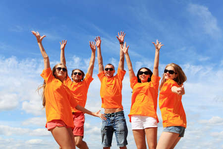 Cheerful young people having fun on a beach. Great summer holidays. Stock Photo - 5133647