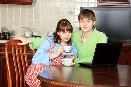 Happy young couple on a kitchen at home. Stock Photo - 5123707