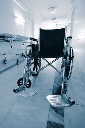 inpatient: Medical theme: a wheel chair in a hospital. Stock Photo