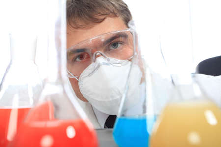 h1n1: Medical theme: serious doctor working in a laboratory.