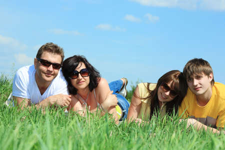 Happy family having a rest together outdoor. Stock Photo - 5158828
