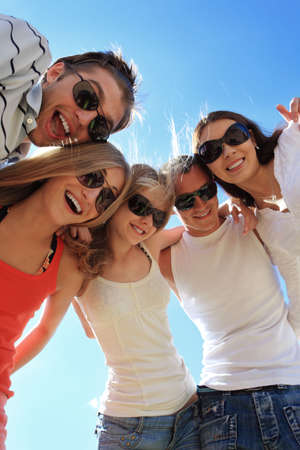 students fun: Cheerful young people having fun on a beach. Great summer holidays.  Stock Photo