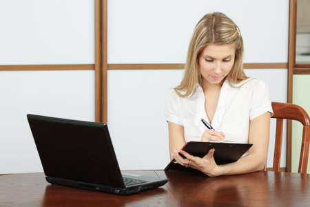 Business theme: beautiful businesswoman in a work process. photo