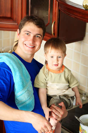 lough: Happy father with his son on a kitchen at home. Stock Photo
