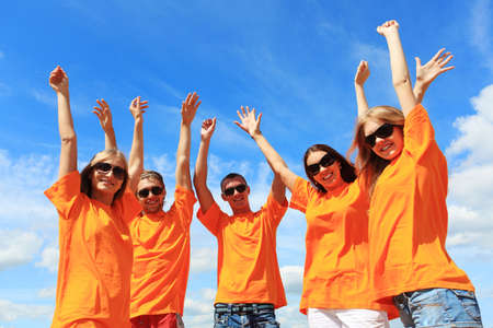 Cheerful young people having fun on a beach. Great summer holidays. Stock Photo - 5161550