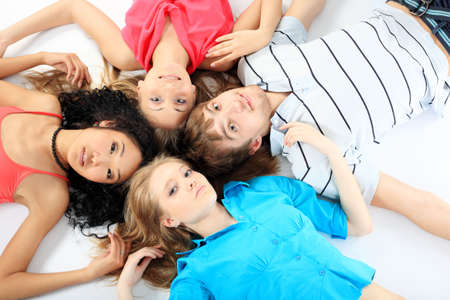 Group of a cheerful young people. Education, holidays. Stock Photo - 5161514