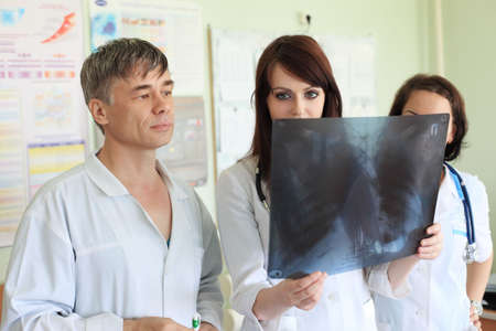 Medical theme: doctors are studying x-ray. photo