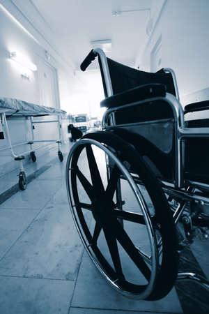 medicine wheel: Medical theme: a wheel chair in a hospital. Stock Photo