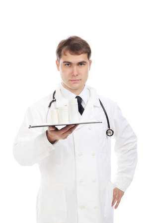 ah1n1: Medical theme: serious doctor holding pills. Stock Photo