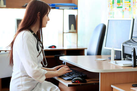nurse computer: Medical theme: student in a classroom. Stock Photo