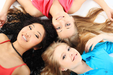 three color: Group of a cheerful young women. Education, holidays.