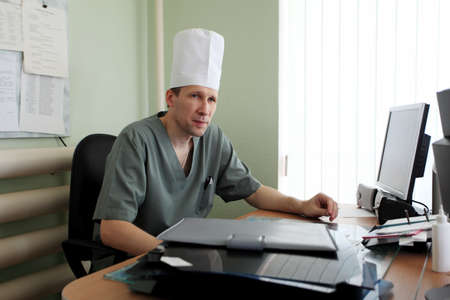 Medical theme: a doctor in a work process. photo