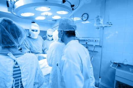 Medical theme: surgeons in operative room. Stock Photo - 5215405