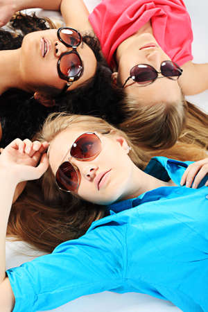 Group of a stylish young women. Education, holidays. photo