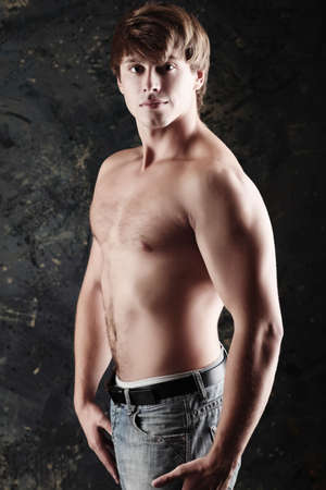 Portrait of a strong muscular male model. Shot in a studio. Stock Photo - 5371193