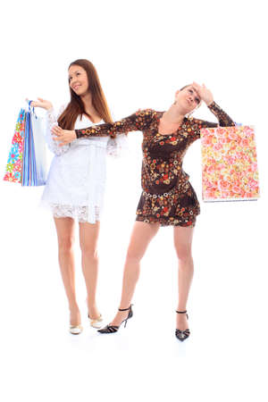 Two beautiful girls enjoying their shopping.  photo