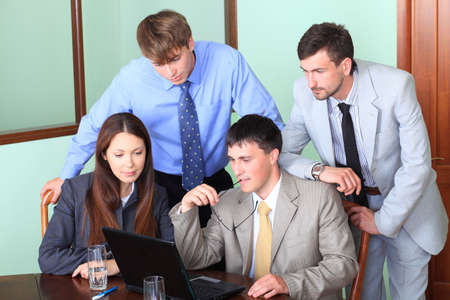 Business theme: business people in a work process in office. Stock Photo - 5384322