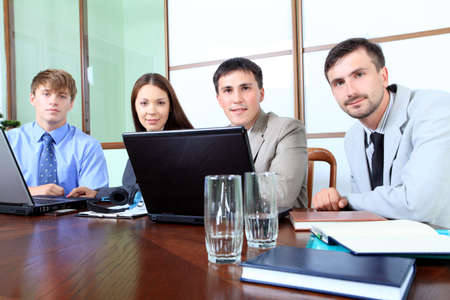 the council: Business theme: business people in a work process in office. Stock Photo