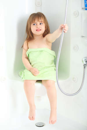 douche: Sweet child taking a bath. Stock Photo