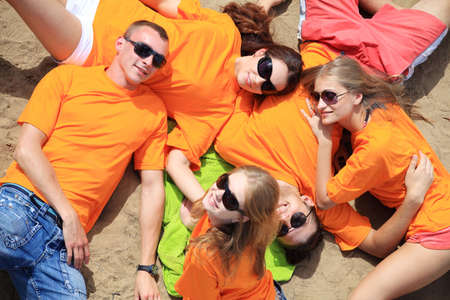 Cheerful young people having fun on a beach. Great summer holidays. Stock Photo - 5395424