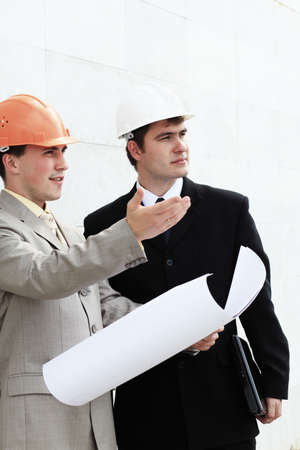 Industrial theme: two blue collars at a site area. Stock Photo - 5395637