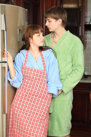 Happy young couple on a kitchen at home. photo