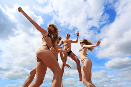 Cheerful young people having fun on a beach. Great summer holidays. Stock Photo - 5477272