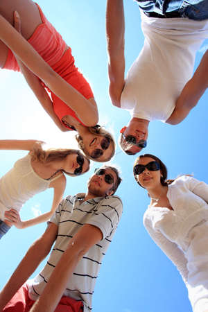 Cheerful young people having fun on a beach. Great summer holidays. Stock Photo - 5477293