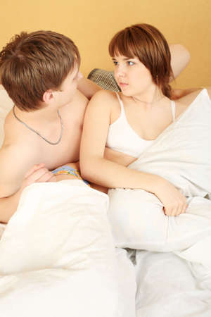 Young couple in a bedroom at home. photo