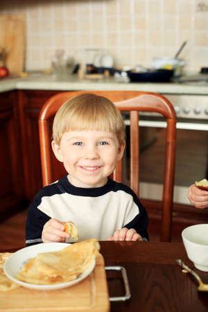 Portrait of a little boy on a kitchen at home. photo