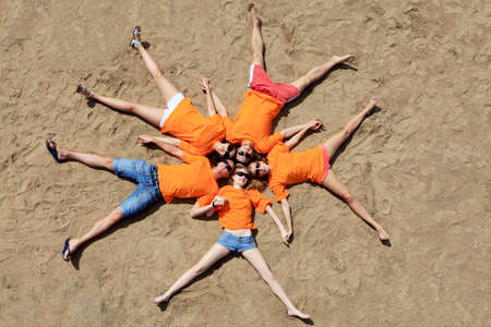 summer fun: Cheerful young people having fun on a beach. Great summer holidays.  Stock Photo