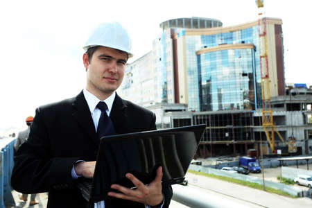 Industrial theme: constructor standing at a site area. Stock Photo - 5530843