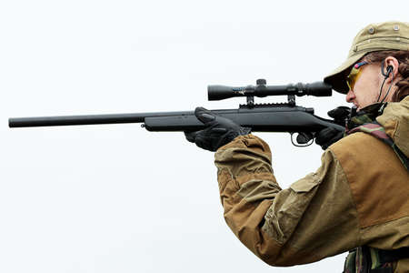 battleground: Shot of a soldier holding gun. Uniform conforms to special services.