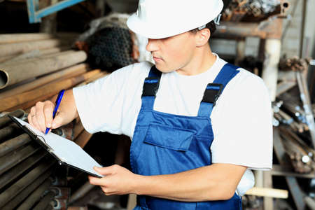 Industrial theme: a worker at a manufacturing area. Stock Photo - 5530780