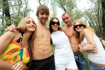 Cheerful young people having fun on a beach. Great summer holidays. Stock Photo - 5509008