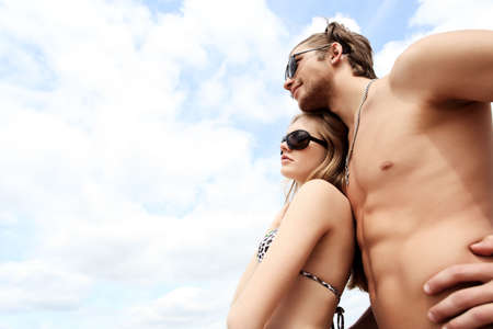 Couple of young people having a rest on a beach. Great summer holidays. Stock Photo - 5509006