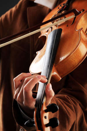 A young woman playing her violin with expression. Stock Photo - 5517480