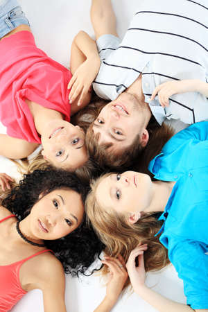 Group of a cheerful young people. Education, holidays. photo