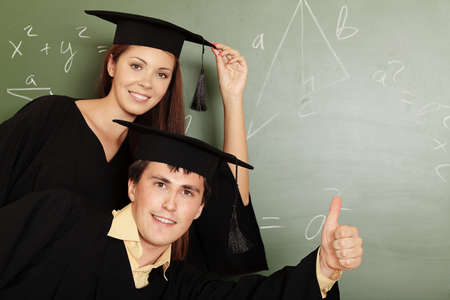 Educational theme: graduating students in academic gown in a classroom. photo