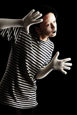 grease paint: Portrait of a female mime in sailors striped vest.