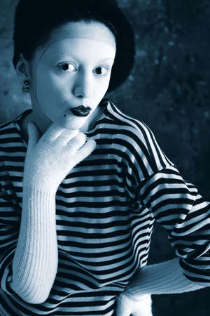 Portrait of a female mime in sailors striped vest. photo