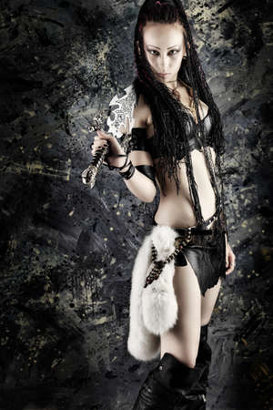catfight: Beautiful female fighter with a sword in her hands. Stock Photo