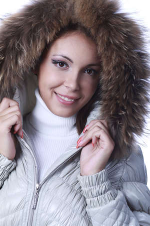 Portrait of a professional female model in winter clothes. photo