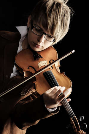 violins: A young woman playing her violin with expression.