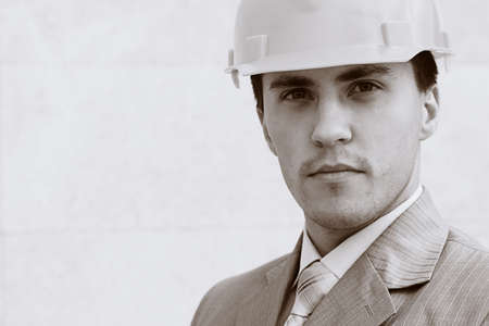 Industrial theme: constructor standing at a building site. photo