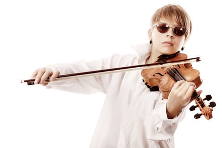 A young woman playing her violin with expression. photo
