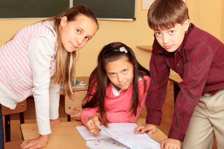 Educational theme: schoolchildren in a classroom. photo
